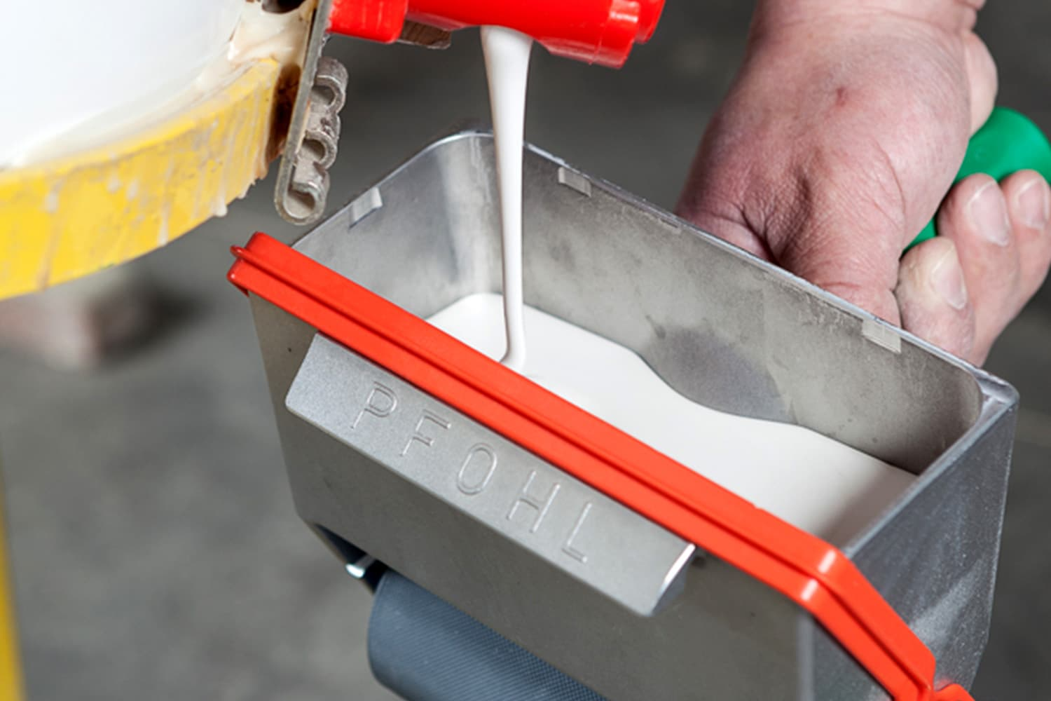 Filling the PFOHL Glue Roller.